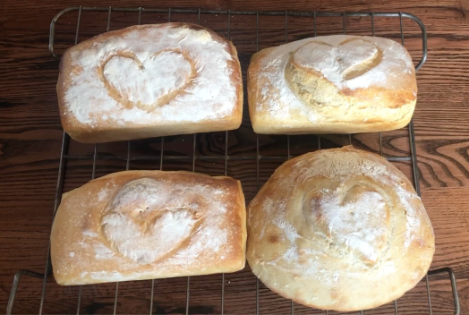 4 warm loaves of white bread